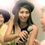 Image of women singing karaoke