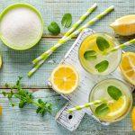 Image of Glasses of Lemonade, Fresh Lemons, Mint & Straws