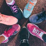 Image of Feet, Sneakers, Joined Together in a Circle