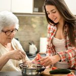 Image of Elder/Younger Females Cooking
