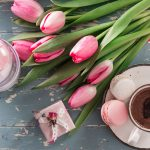 Image of a Cup of Hot Chocolate, Cookies and Tulips lying on a Table